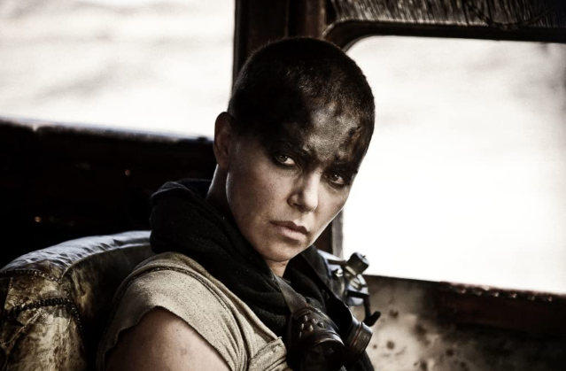 Woman in apocalyptic black makeup sitting in a dirty truck